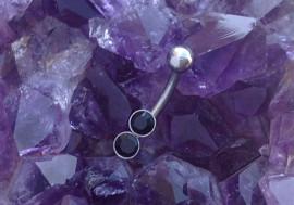 Piercing barre courbe double pierres noires